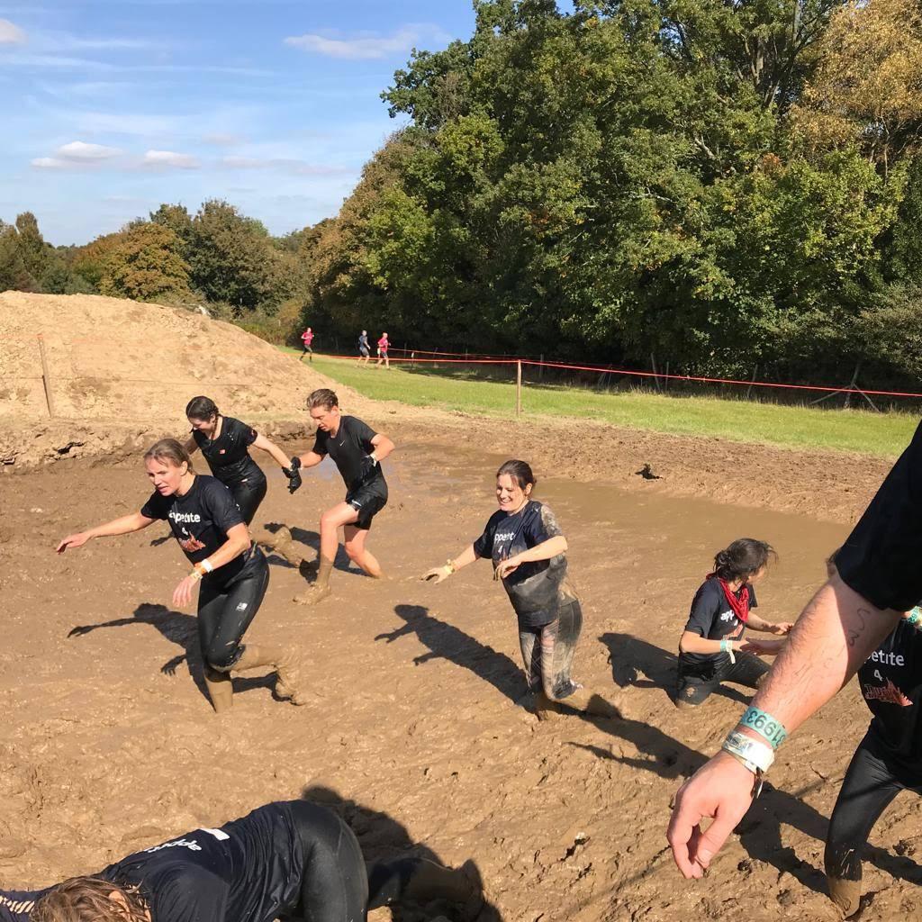 People running in mud