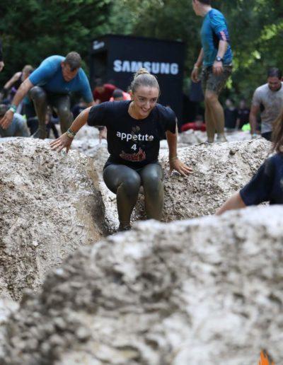 Woman sliding down mud
